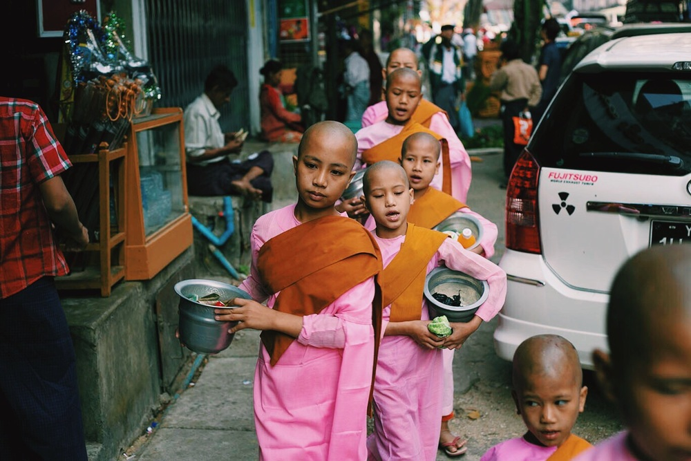 In the mornings, the young monks in Yangon go about town collecting alms from local businesses singing an almost haunting song.