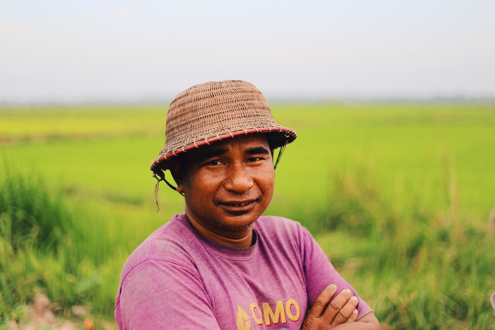 A farmer stands in front of his rice paddies in the Myanmar Delta.