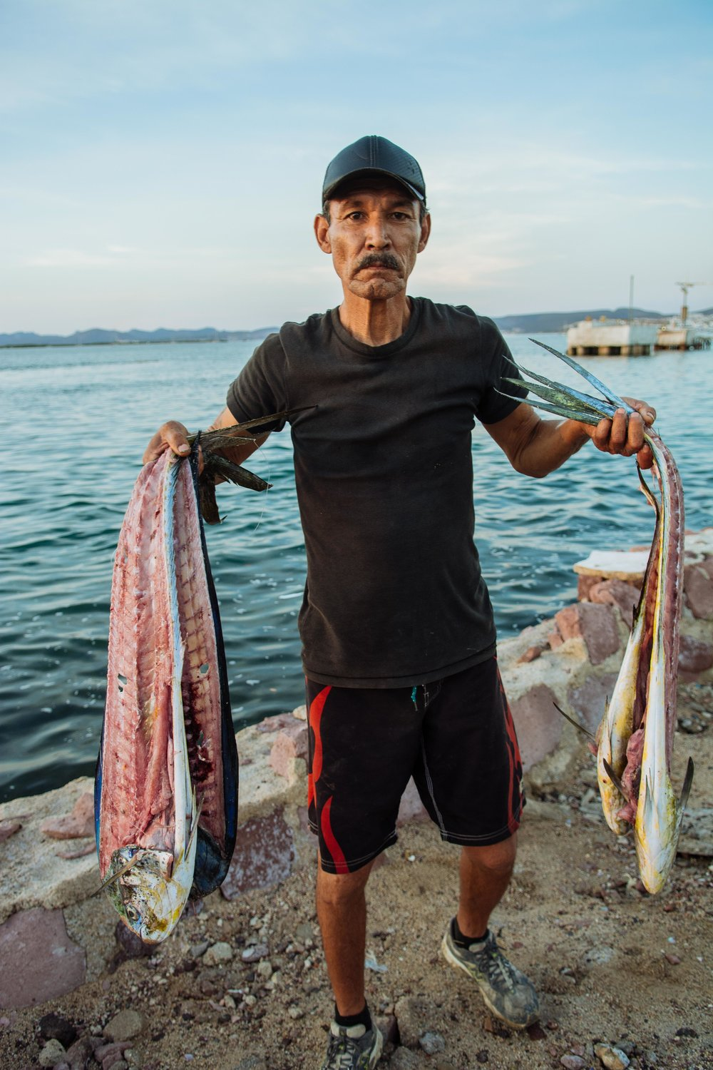 A fisherman in La Paz sells already filleted Mahi Mahi, or Dorado.