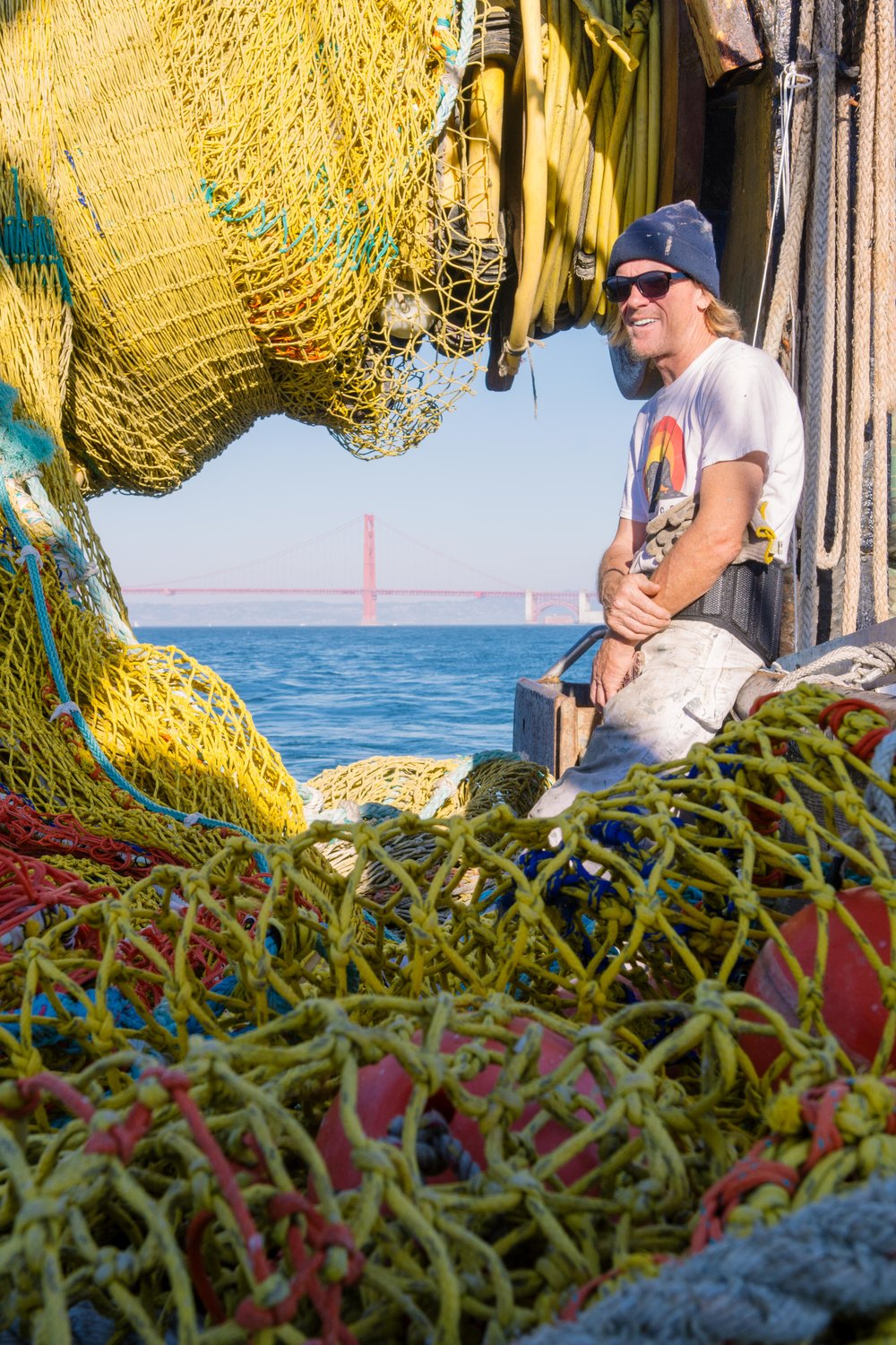 Gregory Greene, a deckhand, sits as we pass out of San Francisco Bay.