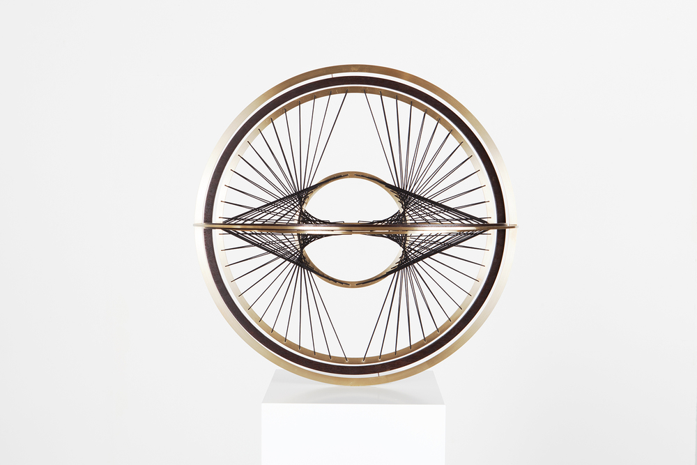 PION, 2015  brass, wood, strings, steel, plinth  60 x 60 x 60 cm
