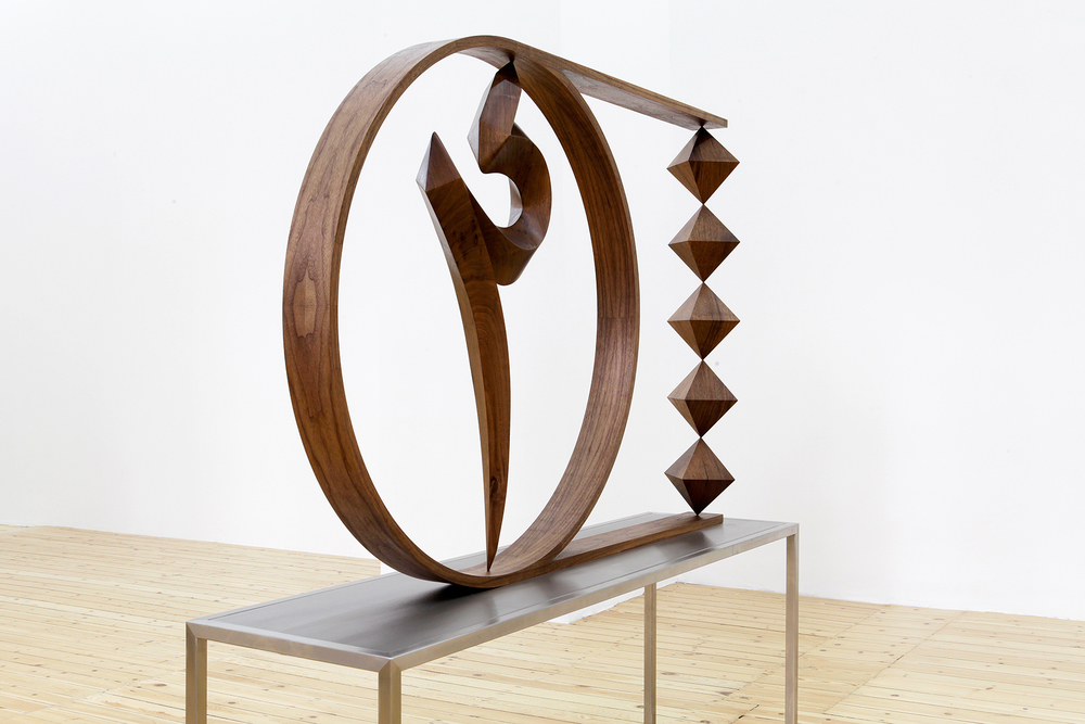 """Unknown Letter I""   2015  wood on steel table  162 x 162 x 42 cm"