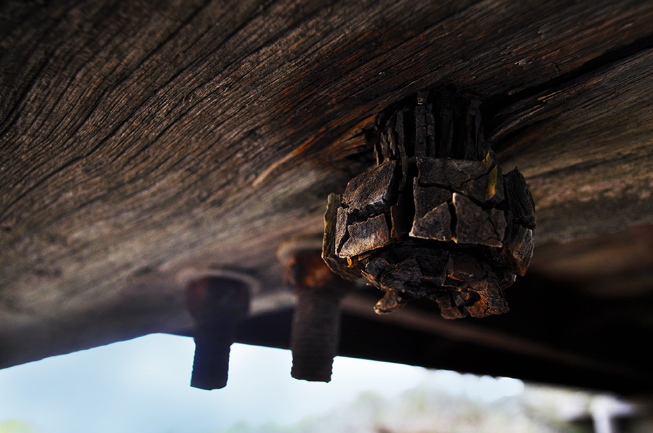 Age old iron bolts supporting a bridge rust to an unrecognizable state