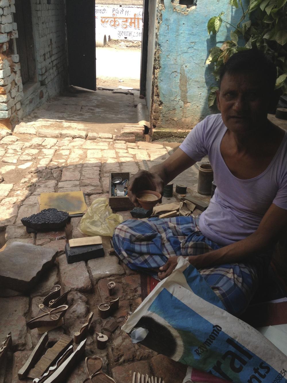 Subbash offering me chai in his shop, Khojwa, Varanasi, 2013
