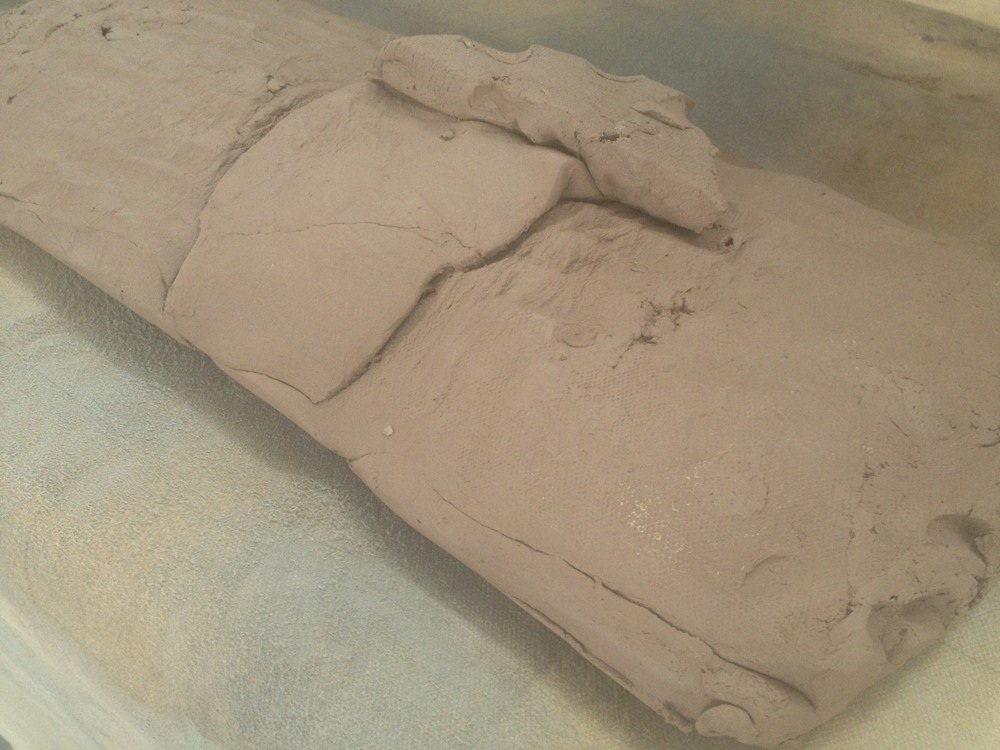 ...the slab roller will make this lumpy pile of clay nice and flat and smooth....