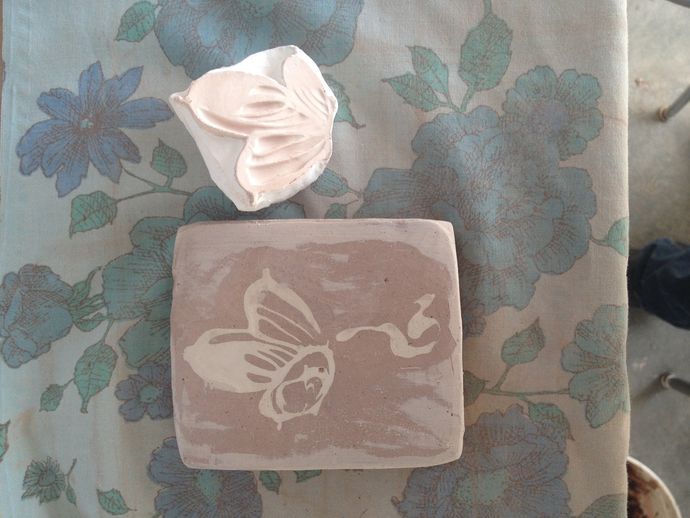 here is a plaster stamp I made of one of the block prints I had made in India....in addition to printing on paper, I am using them as stamps for clay...