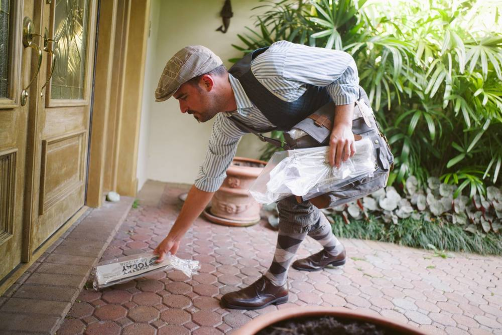 Nicey Jones (local actor Randy Garcia) delivers Poetry Today newspapers to the residents of West Kendall very weekday in April. Photos by Gesi Schilling.