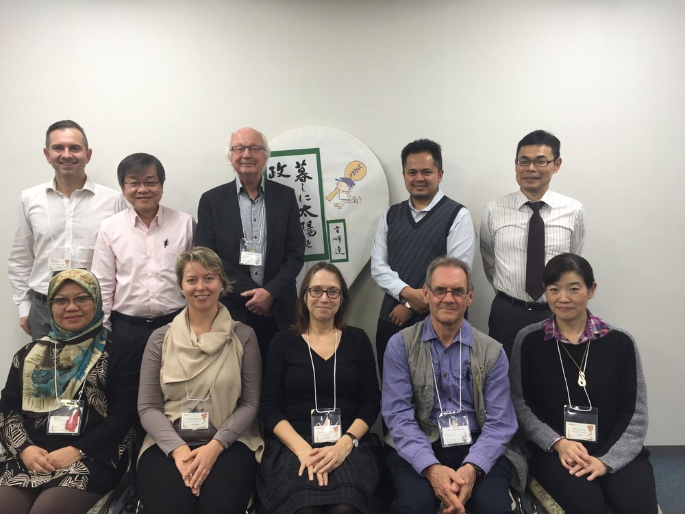Committee members and hosts pictured in front of the Japanese Consumers Association's rice scoop emblem: at the December 2016 meeting of the ISO Unit Pricing Committee.