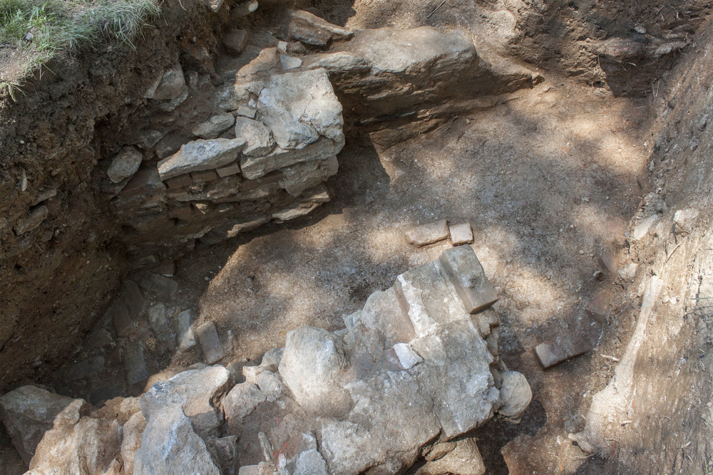 View of the walls and path from above the pit, facing west.