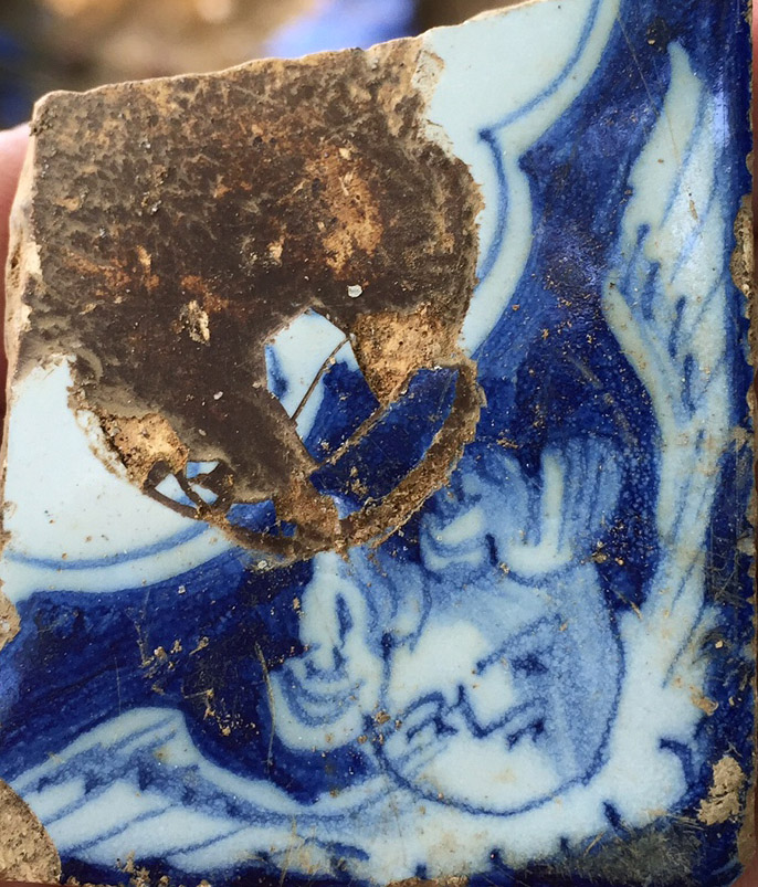 Piece of 18th century delft featuring a cherub's head, found during the excavation.