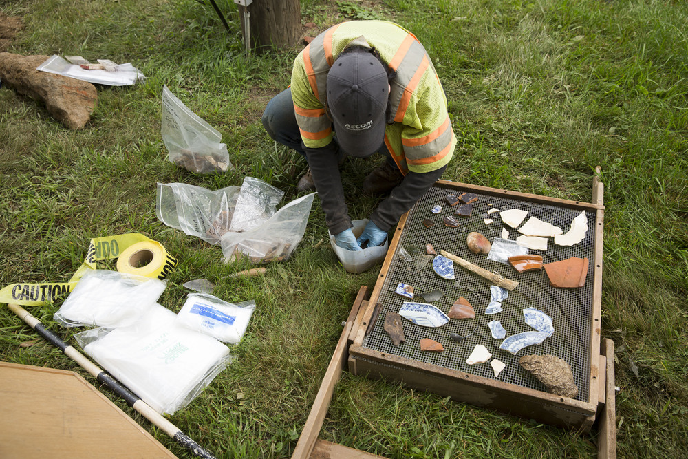 Kim sorts and washes artifacts found during the dig. Photo: Ryan Collerd