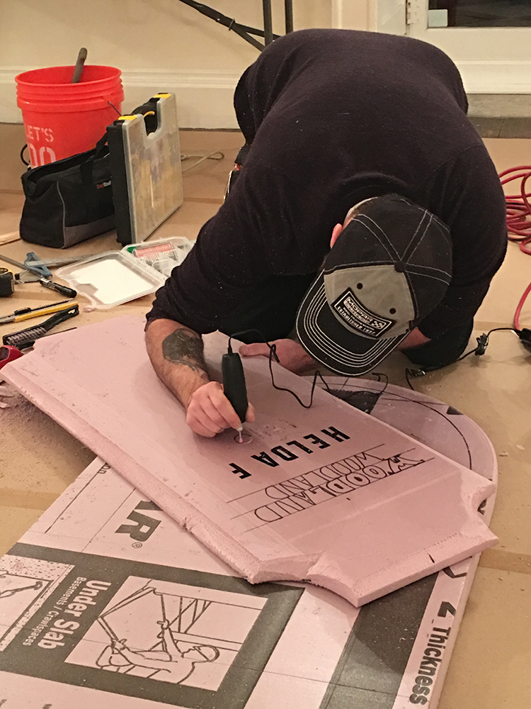 Doug showing all the different techniques to carve and build text on the foam. To get raised letters, you apply concentrated heat over vinyl letters and all the foam around the vinyl melts down revealing crisp text.