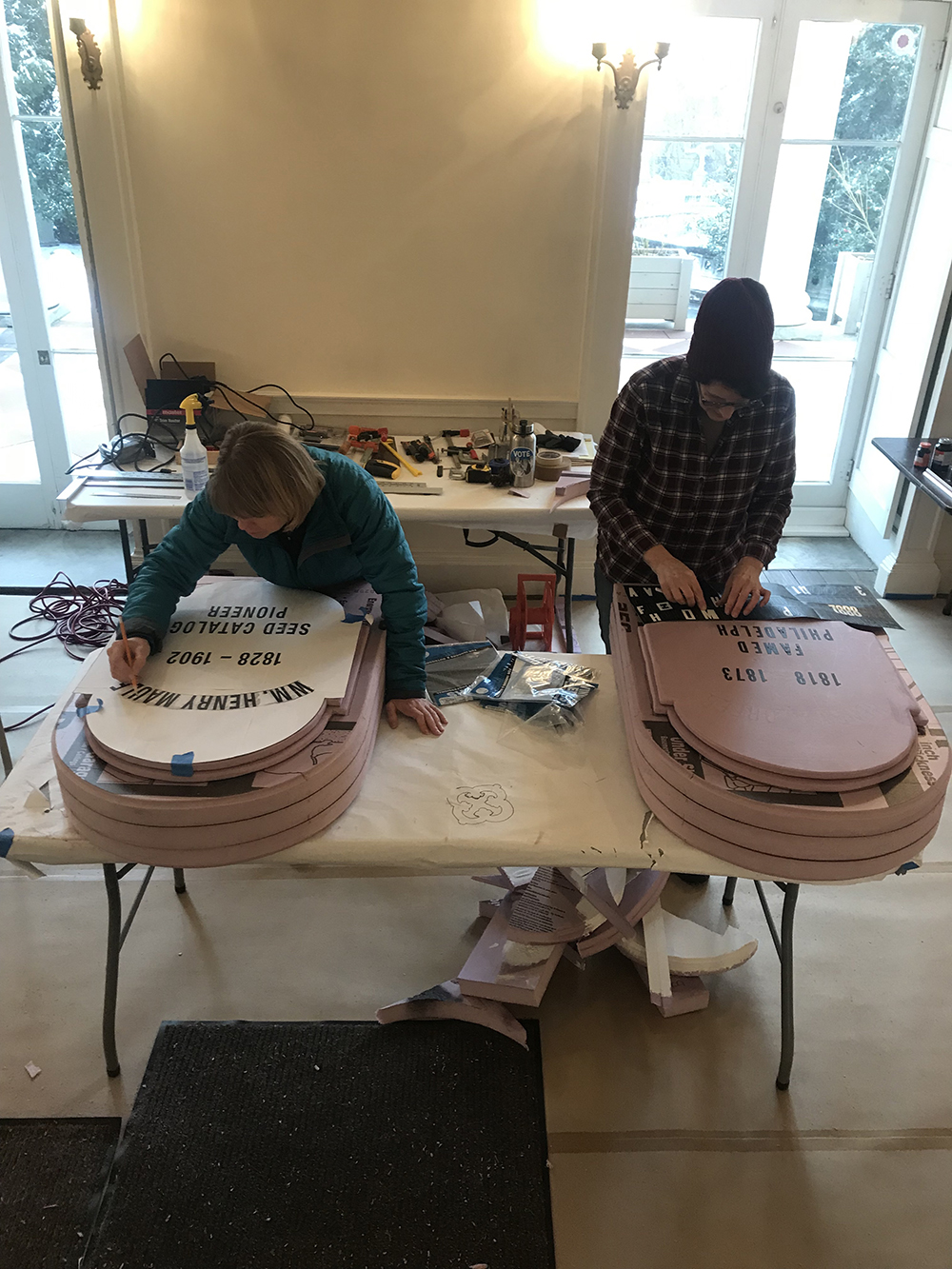 """Grave Gardeners Becca and Sue begin the """"engraving"""" process on Henry Maule and Henry Dreer's headstones."""