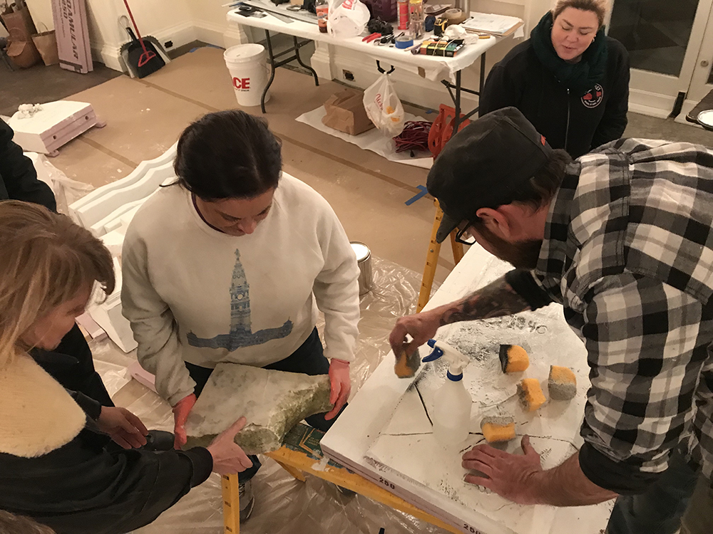 At this point we have three brand spanking new looking headstones, which doesn't fit in a Victorian cemetery scene, so the next step is aging the stones to look like 19th Century marble. Grave Gardeners Becca, Greta, and Rachel Eichelberger take on the challenge.