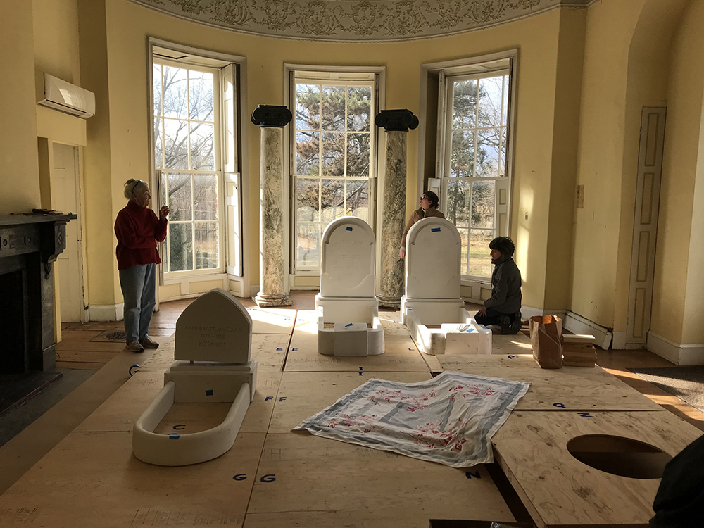 Grave Gardener Peggy Daniel oversees the layout of the family lot in the dining room of the historic Hamilton Mansion.
