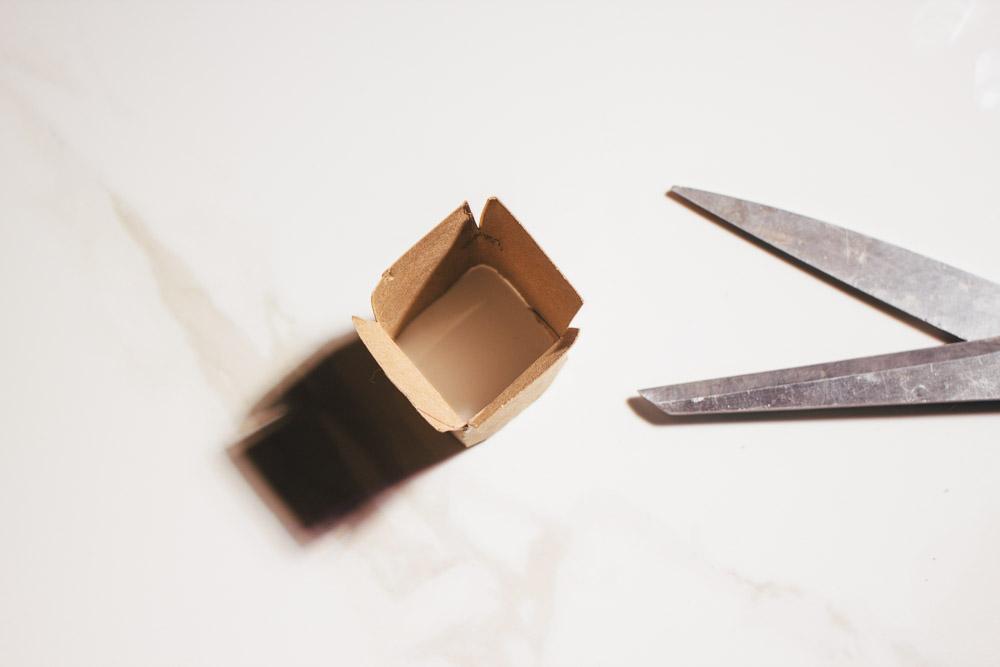 Step 4: Cut half inch slits on 4 corners of the roll