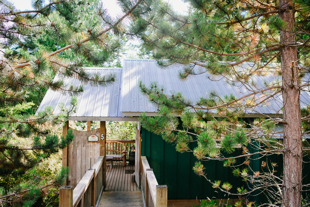 LUMMI COTTAGE    A cosy studio cottage tucked into the woods with a water view, right next to a foot path to the beach. The Lummi is perfect for a romantic couple's getaway or a single person's retreat.  Bedrooms: 1 (studio cabin)  Sleeping Capacity: 2  Internet: Free wi-fi
