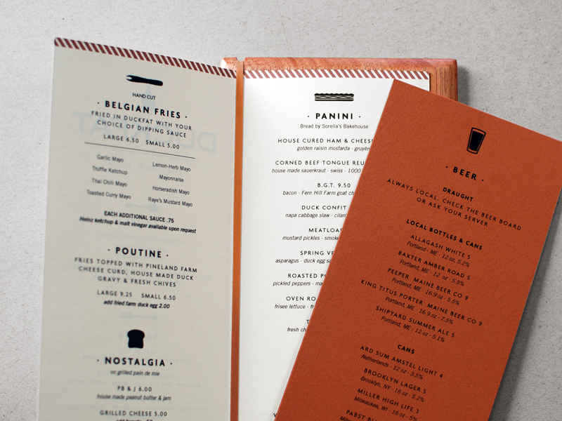Neenah Environments recycled stock was preprinted with the logo and colored borders so that Duckfat staff can easily print new menus in-house and on demand. Wooden menu backers lend an element of hand-craft and add durability to the paper menus.