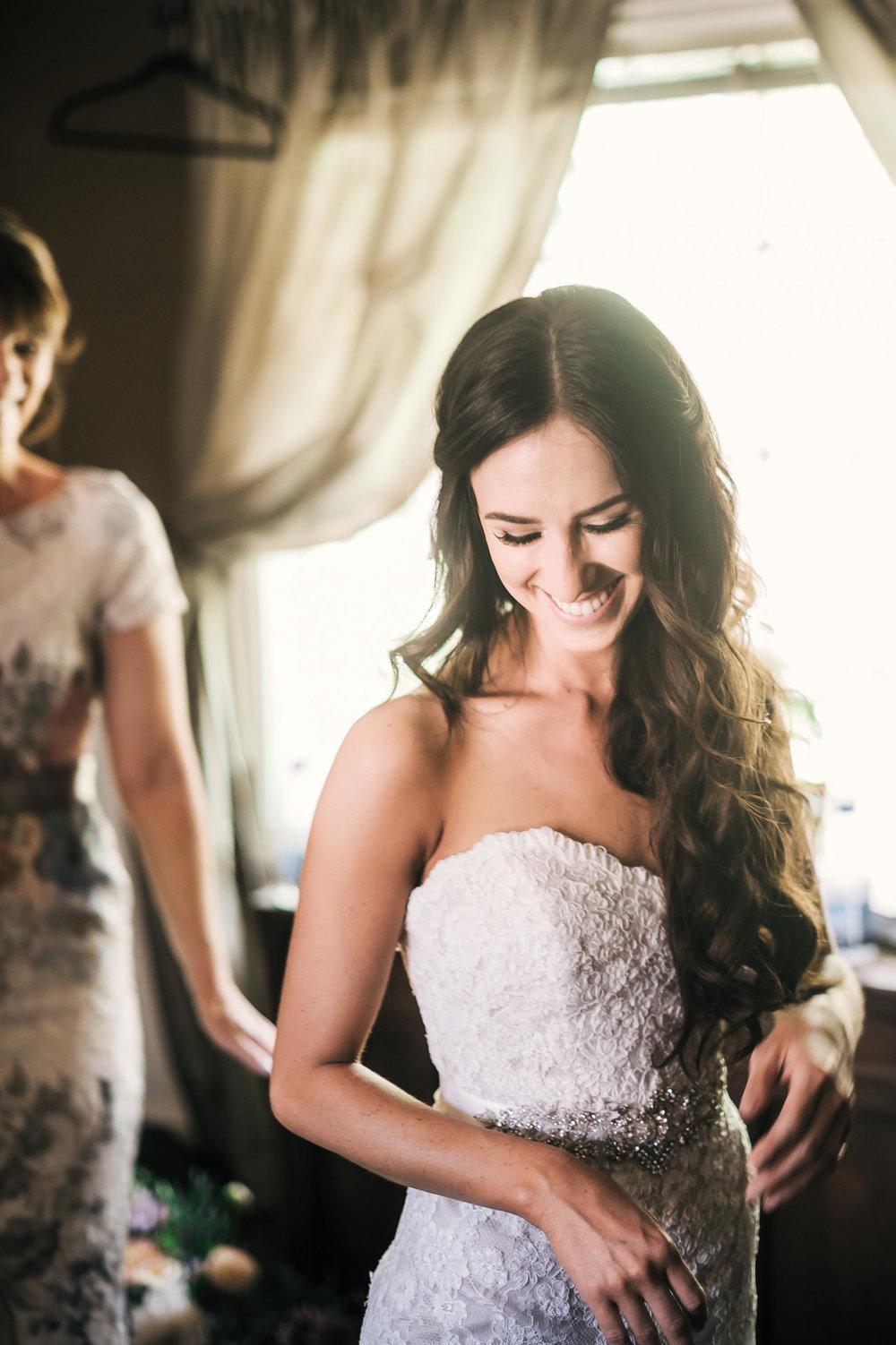 Smiling bride in the bridal suite at the Quail Haven Farm in Vista, California.