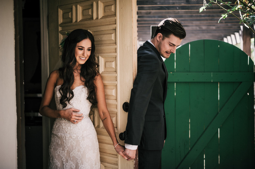 Couple says a prayer and has a first touch before their ceremony.