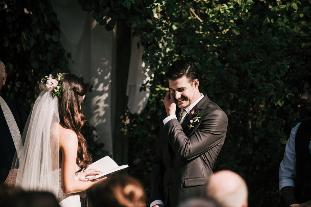 Groom cries during wedding ceremony at quail haven farms vista California