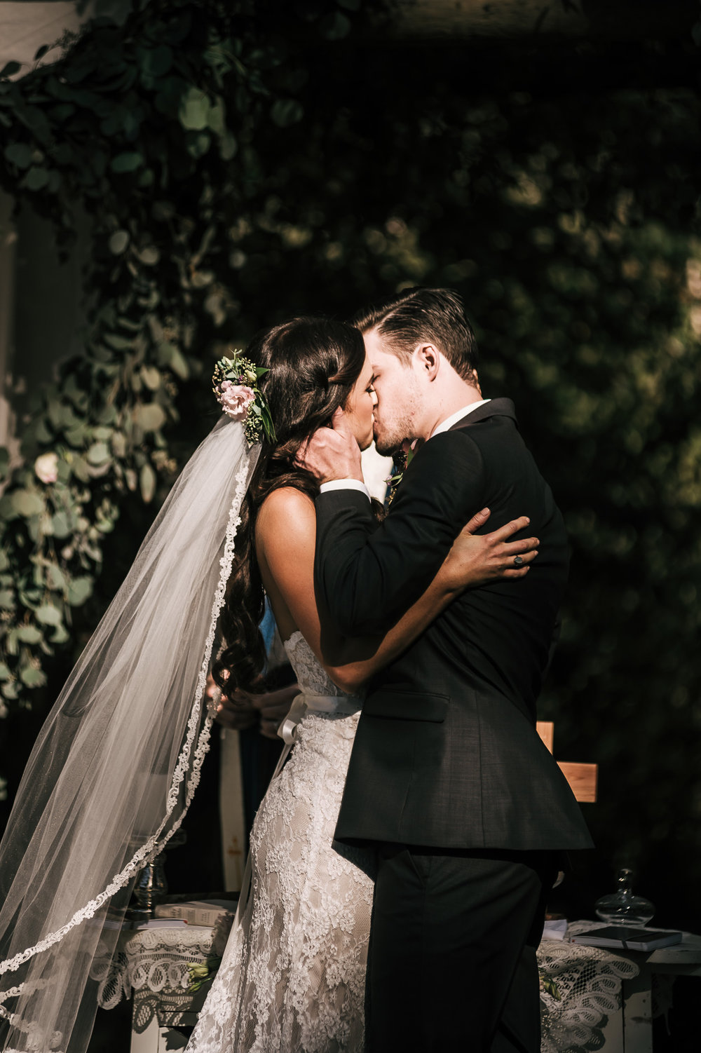 Passionate first kiss at this rustic Quail Haven Farm ceremony.