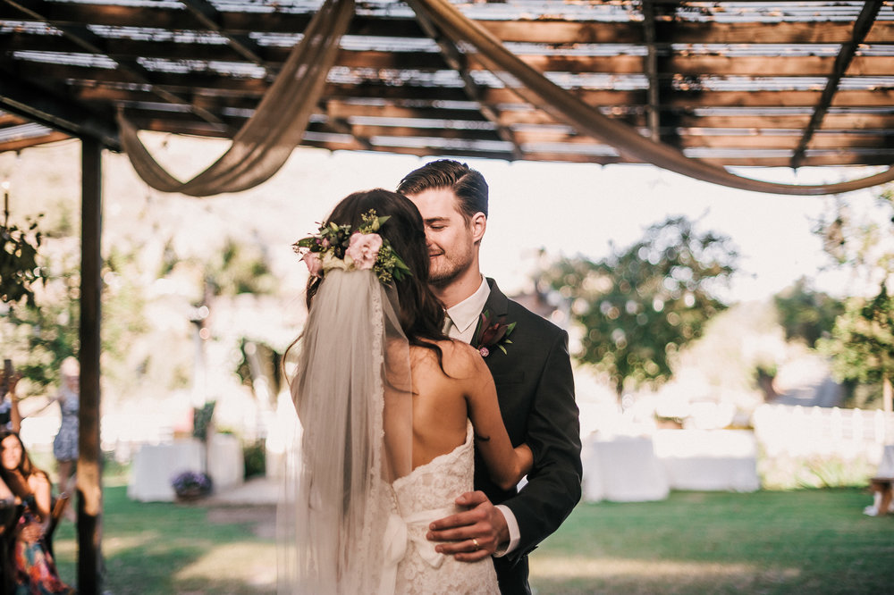 Newlyweds share their first dance as husband and wife at their Quail Haven Farm reception.