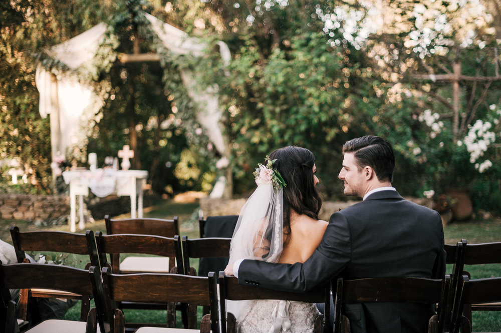 Husband and wife sit and reflect on their beautiful ceremony at the Quail Haven Ranch.