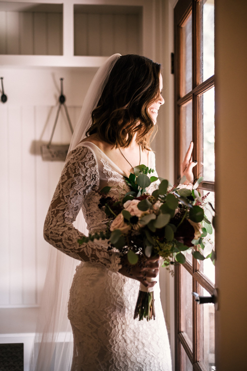 Bride and beautiful lace wedding dress at rustic Pymm ranch wedding venue in Winchester California