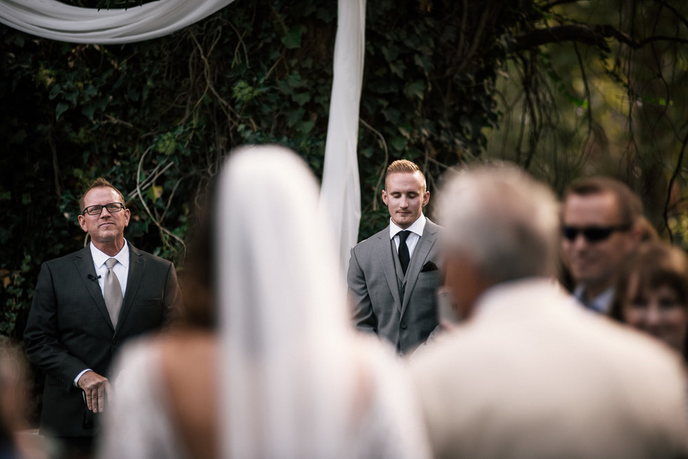 groom sees bride for the first time at rustic pymm ranch wedding venue in winchester california