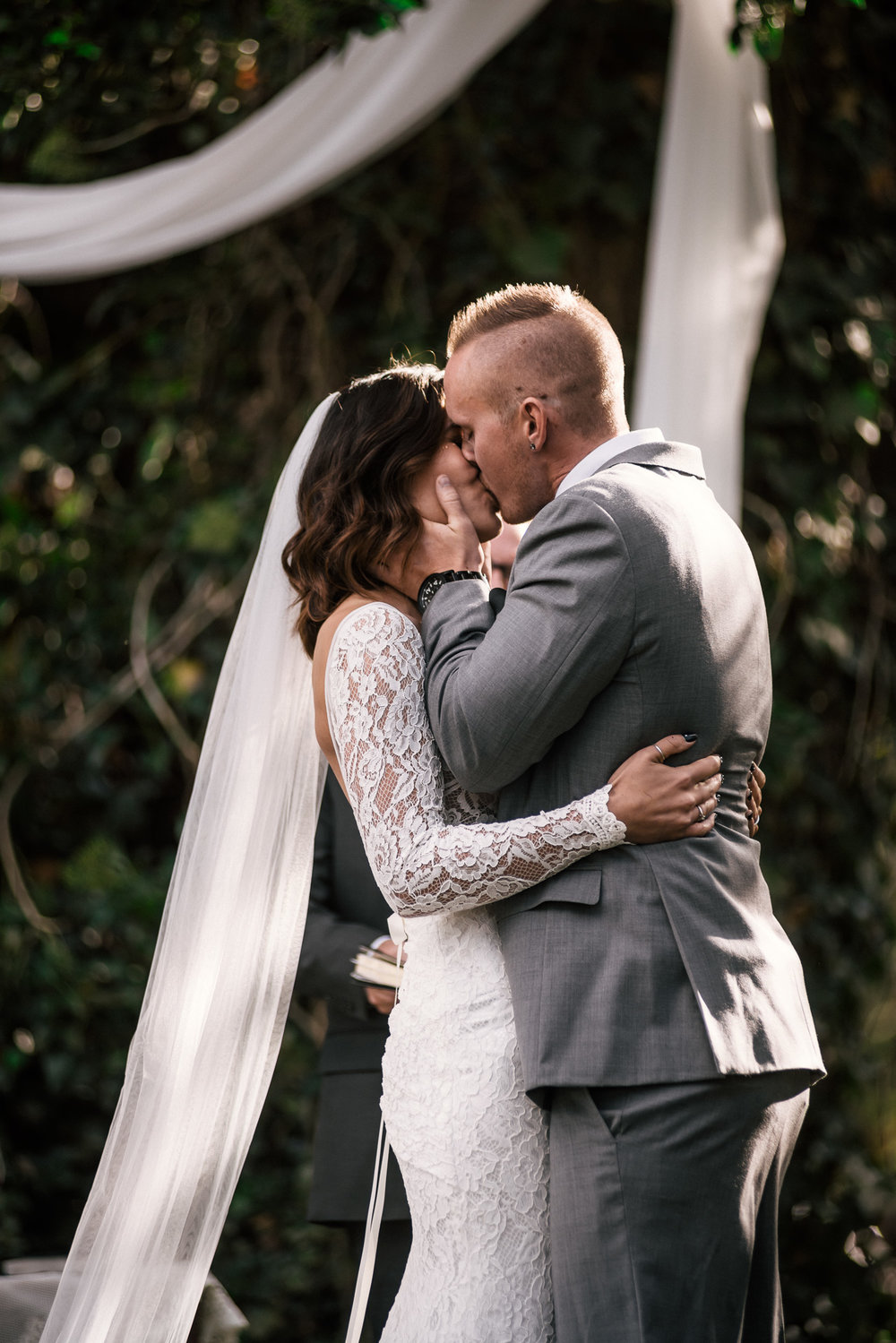 romantic first kiss at rustic pymm ranch wedding venue in winchester california