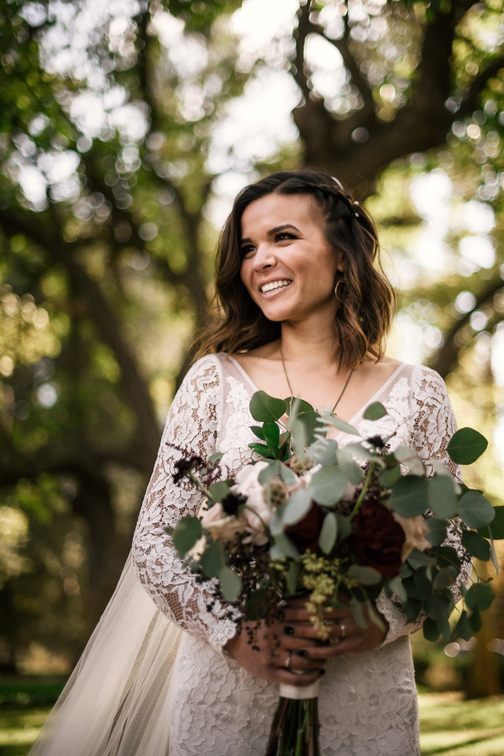 happy bride smiles at rustic pymm ranch wedding venue in winchester california