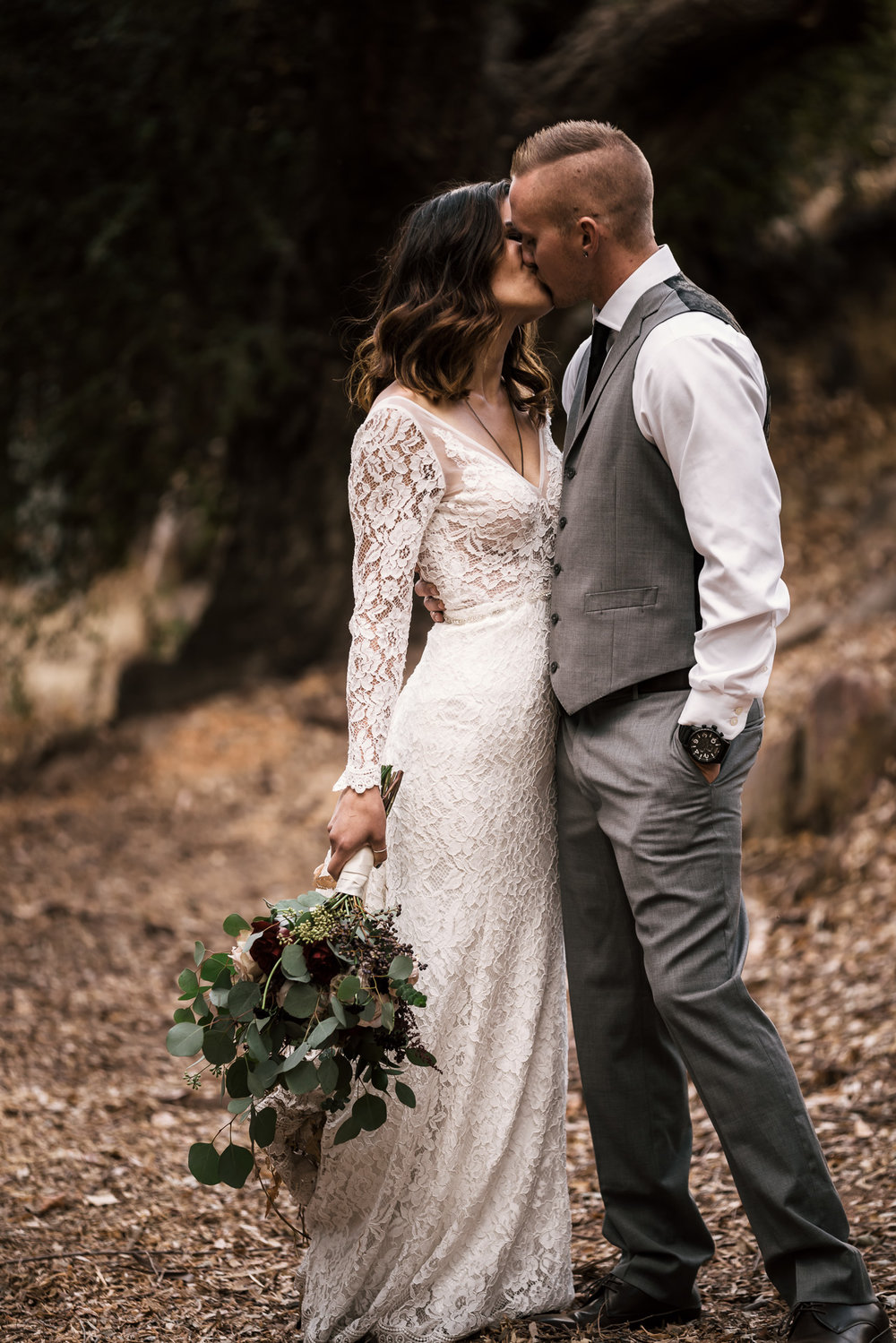 romantic kiss at rustic pymm ranch wedding venue in winchester california