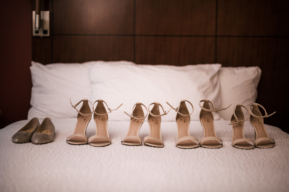 brides shoes among her bridesmaids heels at the Twin Oaks Golf course in san marcos, San diegos premier wedding venue
