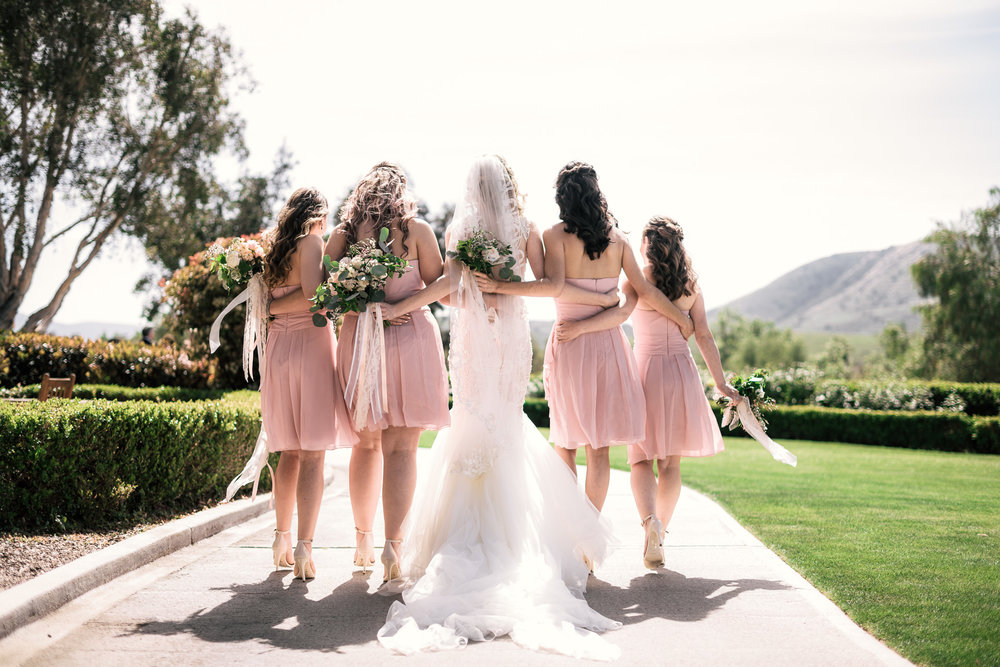 bride walks with her bridesmaids at the Twin Oaks Golf Course in San Marcos, San Diegos premier wedding venue