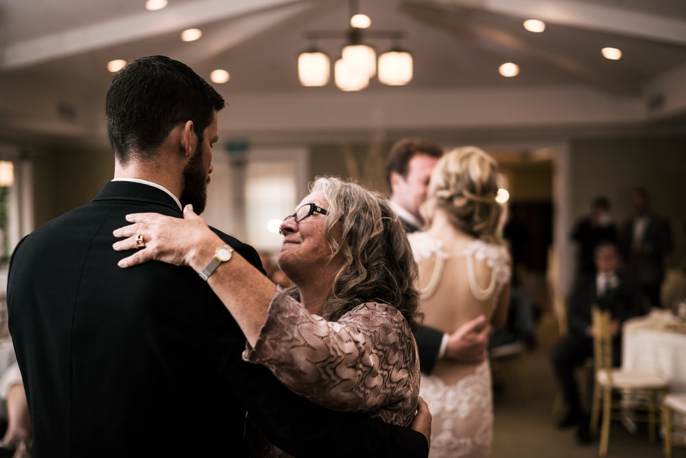 groom dances with his mother at the Twin Oaks Golf Course in San Marcos, San Diegos premier wedding venue