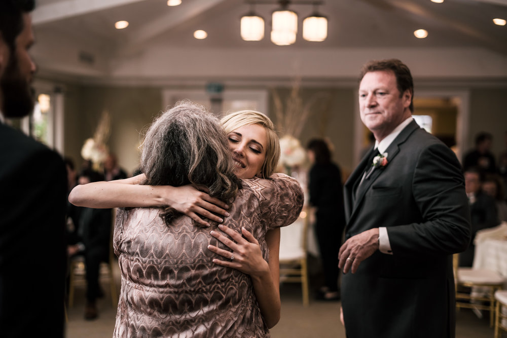 bride gives her mother in law a hug at the Twin Oaks Golf Course in San Marcos, San Diegos premier wedding venue