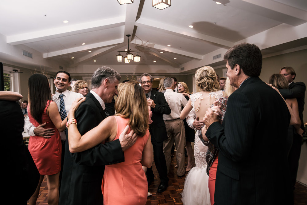 guests join the bride and groom on the dance floor at the Twin Oaks Golf Course in San Marcos, San Diegos premier wedding venue