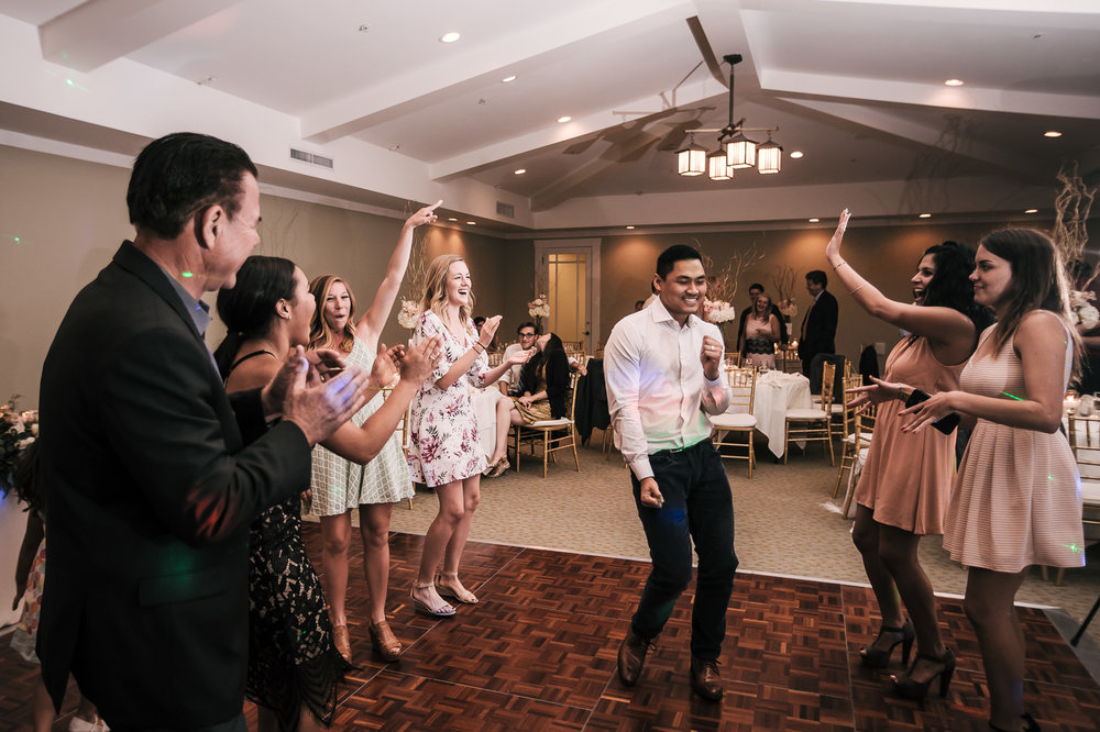 guests have a great time during wedding reception at the Twin Oaks Golf Course in San Marcos, San Diegos premier wedding venue