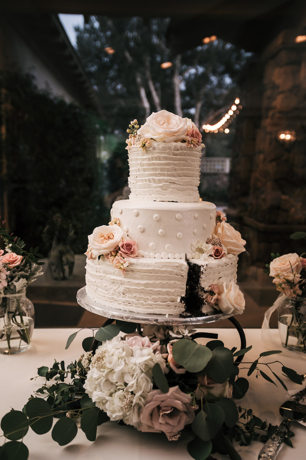 beautiful wedding cake after caek cutting at the Twin Oaks Golf Course in San Marcos, San Diegos premier wedding venue