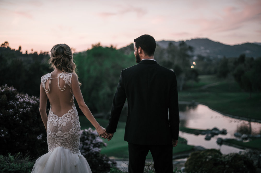 bride and groom watch the sunset at the Twin Oaks Golf Course in San Marcos, San Diegos premier wedding venue