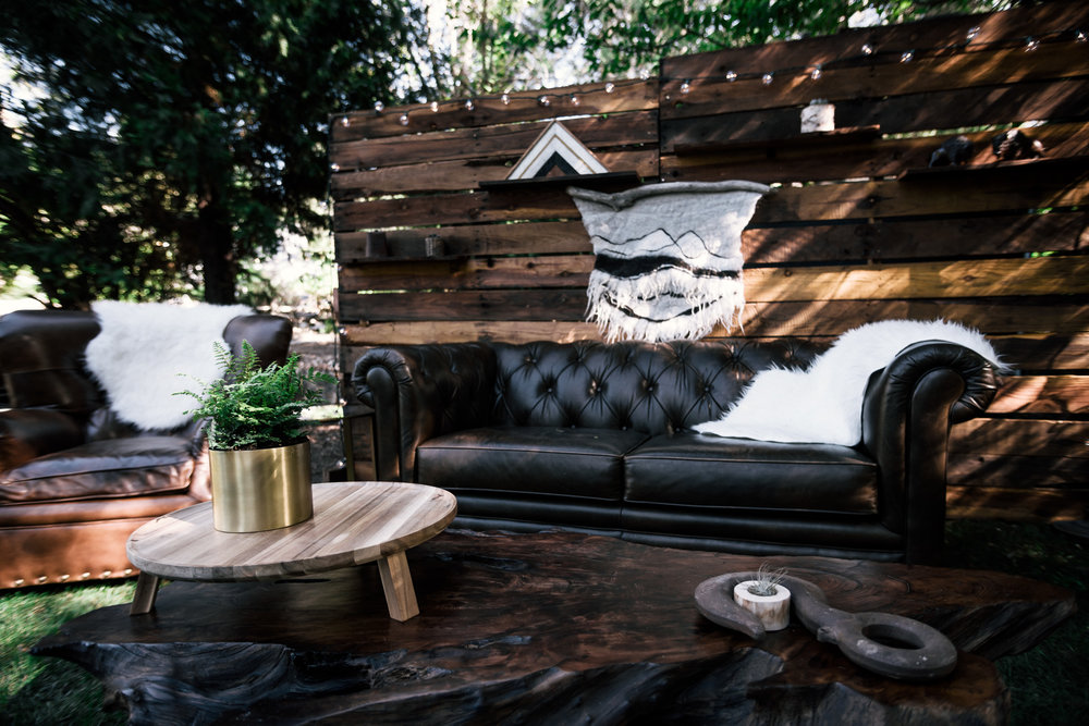 stained pallet wall and leather couch guest seating area shot by wedding photographer at the charming St. George Hotel in Volcano California