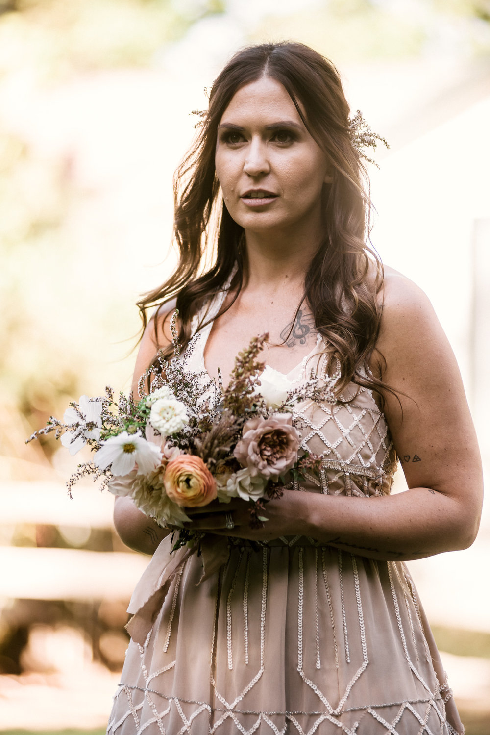 bridesmaid and her bouquet shot by wedding photographer at the charming St. George Hotel in Volcano California
