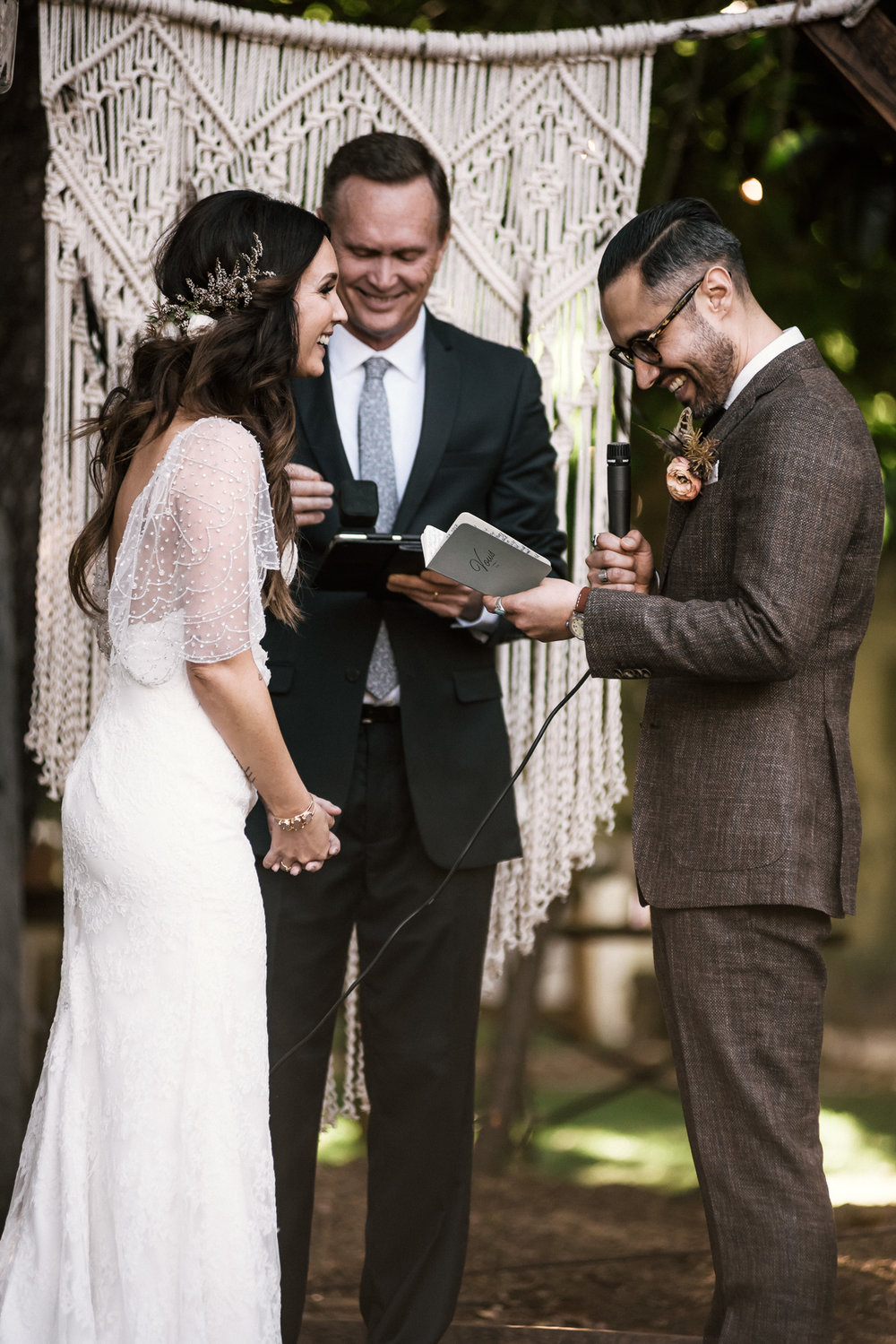 groom reads his wedding vows shot by wedding photographer at the charming St. George Hotel in Volcano California