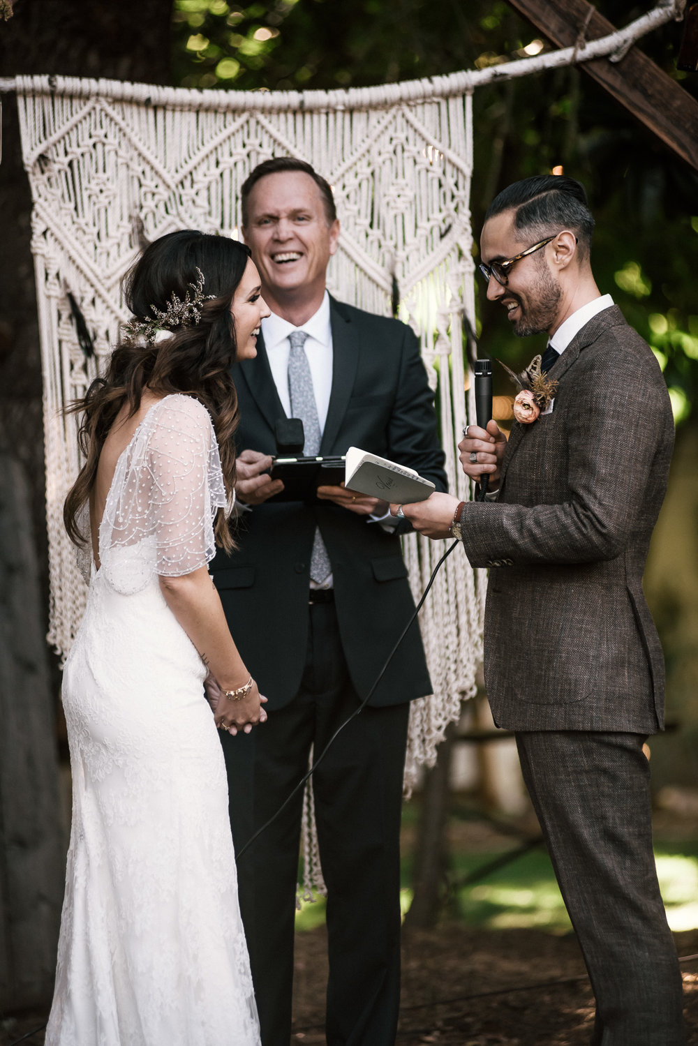 bride laughs at grooms joke shot by wedding photographer at the charming St. George Hotel in Volcano California