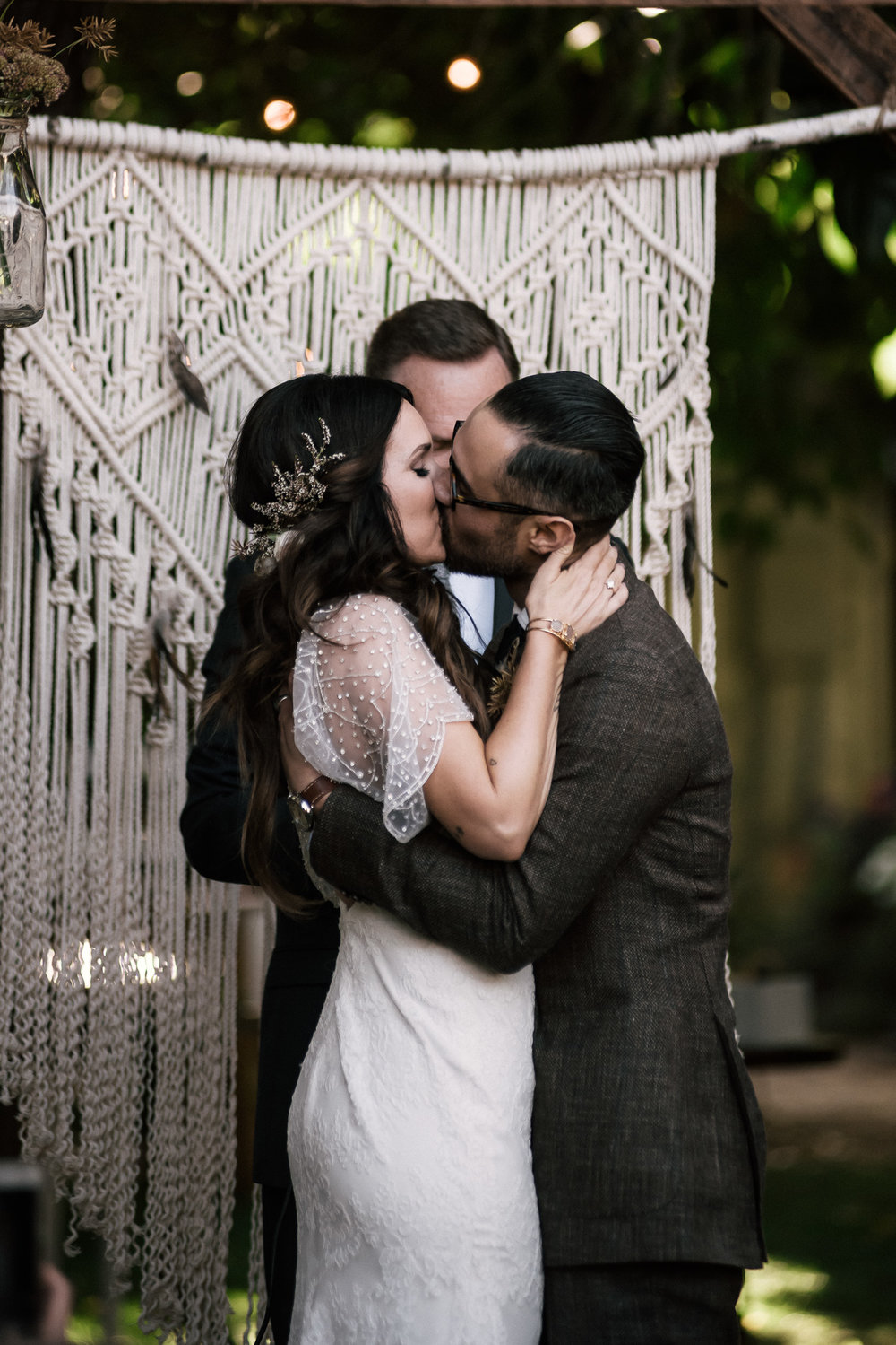 First kiss as husband and wife shot by wedding photographer at the charming St. George Hotel in Volcano California