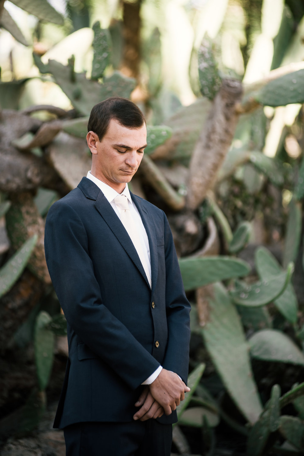 Groom tries to stay calm as he eagerly awaits his bride captured by photographer during romantic wedding at the historic Leo Carrillo Ranch in Carlsbad California