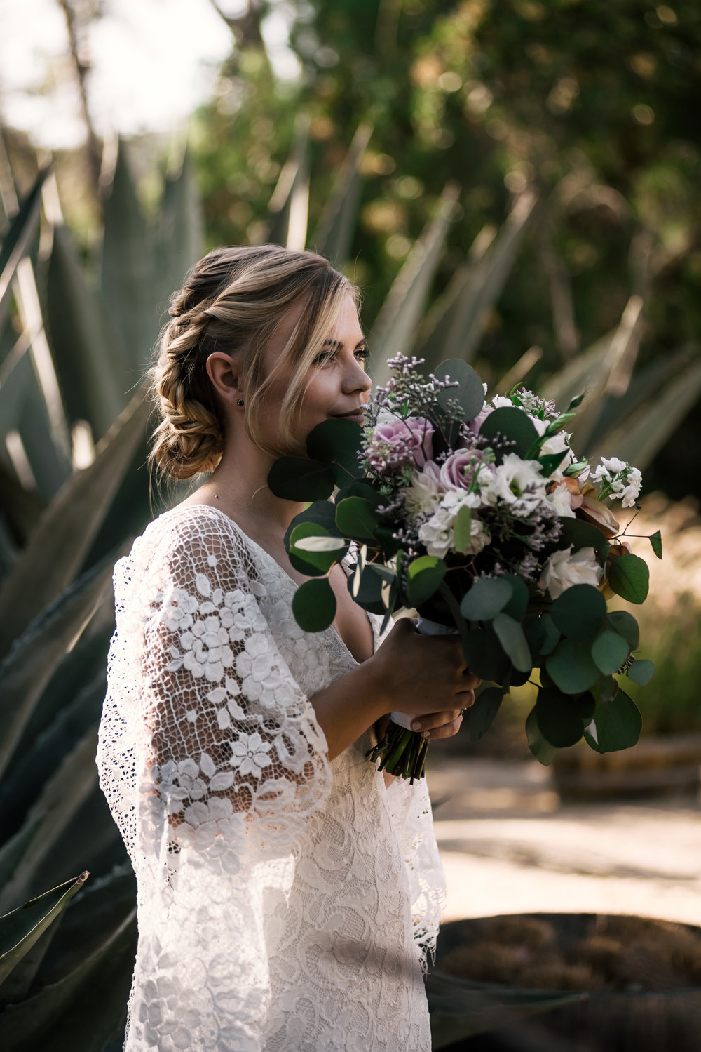 bride shows off her beautiful flower bouquet captured by photographer during romantic wedding at the historic Leo Carrillo Ranch in Carlsbad California