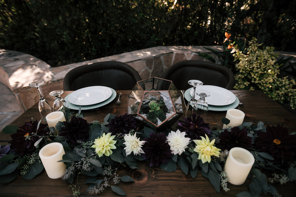 copper geometric terrarium with succulents adorns the head table captured by photographer during romantic wedding at the historic Leo Carrillo Ranch in Carlsbad California
