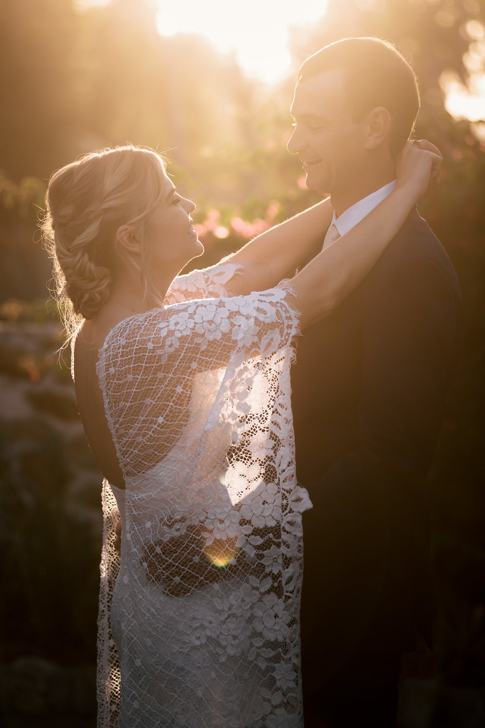 bride and groom a wash in the light of the setting sun captured by photographer during romantic wedding at the historic Leo Carrillo Ranch in Carlsbad California